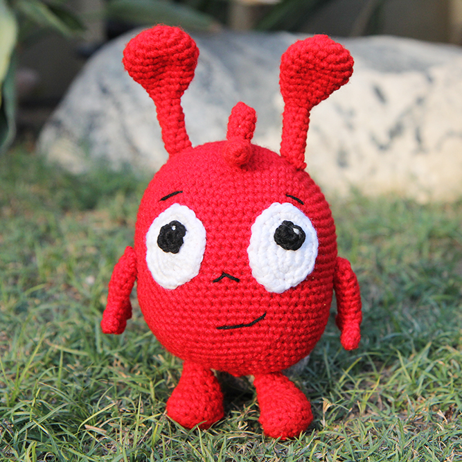 completed crochet morphle standing in the grass